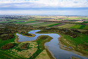 Nederland, Zeeland, Gemeente Terneuzen, 19-10-2014; Braakman en Braakmanpolder , voormalige zeearm.  Braakmankrek. Westerschelde aan de horizon.<br /> Nature reserve Braakman polder, a former estuary.<br /> luchtfoto (toeslag op standard tarieven);<br /> aerial photo (additional fee required);<br /> copyright foto/photo Siebe Swart