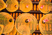 "12 APRIL 2012 - HO CHI MINH CITY, VIETNAM:  Incense coils hanging from the ceiling of Chùa Bà Thiên Hu (The Pagoda of the Lady Thien Hau), a Chinese style temple located on Nguyen Trai Street in Cholon. It is dedicated to Thiên Hu, the Lady of the Sea (""Tian Hou"" as transcribed from the Chinese). Cholon is the Chinese-influenced section of Ho Chi Minh City (former Saigon). It is the largest ""Chinatown"" in Vietnam. Cholon consists of the western half of District 5 as well as several adjoining neighborhoods in District 6. The Vietnamese name Cholon literally means ""big"" (lon) ""market"" (cho). Incorporated in 1879 as a city 11 km from central Saigon. By the 1930s, it had expanded to the city limit of Saigon. On April 27, 1931, French colonial authorities merged the two cities to form Saigon-Cholon. In 1956, ""Cholon"" was dropped from the name and the city became known as Saigon. During the Vietnam War (called the American War by the Vietnamese), soldiers and deserters from the United States Army maintained a thriving black market in Cholon, trading in various American and especially U.S Army-issue items.         PHOTO BY JACK KURTZ"