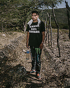 Twenty-year-old Jesus Pineda Corona helping the search effort. His shirt reads: I will search for you until I find you.""