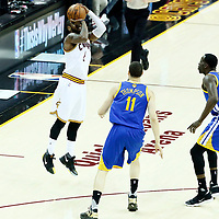 07 June 2017: Cleveland Cavaliers guard Kyrie Irving (2) takes a jump shot over Golden State Warriors guard Klay Thompson (11) and Golden State Warriors forward Draymond Green (23) during the Golden State Warriors 118-113 victory over the Cleveland Cavaliers, in game 3 of the 2017 NBA Finals, at  the Quicken Loans Arena, Cleveland, Ohio, USA.