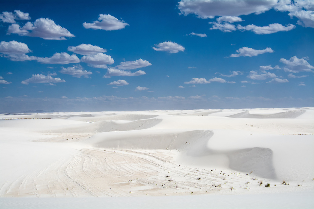 View of the desert dunes, valleys and sky at New Mexico's White Sands National Monument.