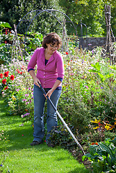 Weeding a border with a hoe