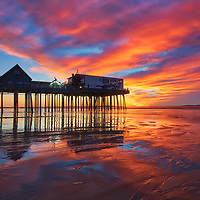 New England photography of a sunrise at Old Orchard Beach and its historic pier near Portland Maine. <br />