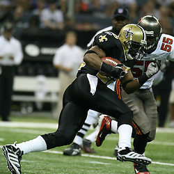 2007 December, 2: New Orleans Saints running back Reggie Bush (25) runs towards Buccaneers linebacker Derrick Brooks (55) during a 27-23 win by the Tampa Bay Buccaneers over the New Orleans Saints at the Louisiana Superdome in New Orleans, LA.