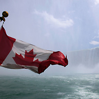 Canada, Ontario, Niagara Falls. Canadian flag on the Maid of the Mist at Niagara Falls.