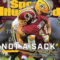 October 8, 2018 Sports Illustrated Cover:<br /> Football: Green Bay Packers Clay Matthews (52) in action, tackle vs Washington Redskins QB Alex Smith (11) at FedEx Field. The tackle was flagged for a roughing the passer penalty.<br /> Landover, MD 9/23/2018<br /> CREDIT: Mark Goldman/Icon Sportswire (Photo by SI Cover /Sports Illustrated/Getty Images)