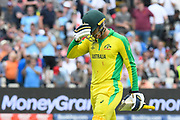 Wicket - Alex Carey of Australia looks dejected as he walks back to the pavilion after being dismissed by Adil Rashid of England during the ICC Cricket World Cup 2019 semi final match between Australia and England at Edgbaston, Birmingham, United Kingdom on 11 July 2019.