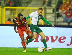 BRUSSELS, BELGIUM - Tuesday, October 15, 2013: Wales' Craig Bellamy in action against Belgium's Timmy Simons during the 2014 FIFA World Cup Brazil Qualifying Group A match at the Koning Boudewijnstadion. (Pic by David Rawcliffe/Propaganda)