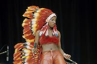 Chaka Khan, lead singer of American funk group Rufus, performing in a native American costume, circa 1975.