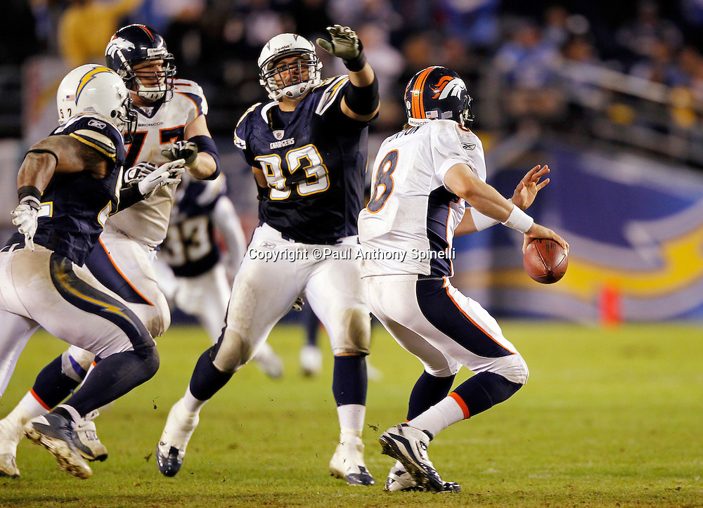 Denver Broncos quarterback Kyle Orton (8) rolls out to avoid pressure from San Diego Chargers linebacker Antwan Applewhite (90) and San Diego Chargers defensive end Luis Castillo (93) during the NFL week 11 football game against the San Diego Chargers on Monday, November 22, 2010 in San Diego, California. The Chargers won the game 35-14. (©Paul Anthony Spinelli)