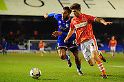 Luke Higham of Blackpool FC and Aaron Holloway of Oldham Athletic (On loan from Wycombe Wanderers) battle for the ball during the Sky Bet League 1 match between Oldham Athletic and Blackpool at SportsDirect.Com Park, Oldham, England on 15 March 2016. Photo by Mike Sheridan.
