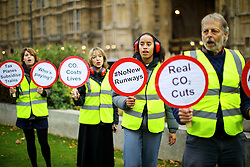 © Licensed to London News Pictures. 25/10/2016. London, UK. 'Reclaim the Power' and 'Plane Stupid' activists protest against airport expansion by staging a mock runway blockade at College Green in Westminster, London on 25 October 2016. Photo credit: Tolga Akmen/LNP