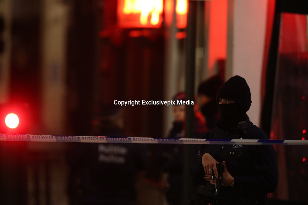 Nov. 22, 2015 - Brussels, BELGIUM - 20151122 - BRUSSELS, BELGIUM: <br /> <br /> Police intervention near the Brussels Lombardstraat/ rue du Lombard - Kolenmarkt/ rue du marche au Charbon , Sunday 22 November 2015, in Brussels. The terrorist threat level was updated to level four, the maximum, in Brussels region, and stays at level three for the rest of the country. Shopping center, main shopping streets, subways and public events are closed and cancelled for the week-end because of the terrorist threat level four.<br /> ©Exclusivepix Media