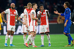 Ryan Babel #49 of Ajax, Dusan Tadic #10 of Ajax, Quincy Promes #11 of Ajax after the Europa League match R32 second leg between Ajax and Getafe at Johan Cruyff Arena on February 27, 2020 in Amsterdam, Netherlands