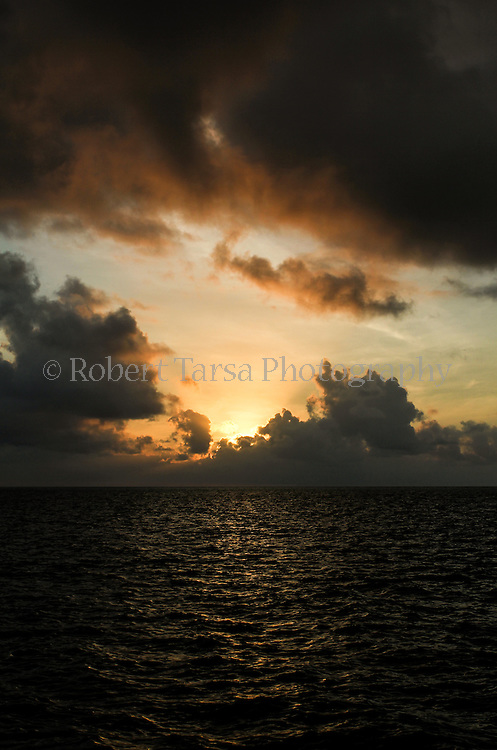 Sunrise in Belize as seen from 40 miles off the mainland coast.