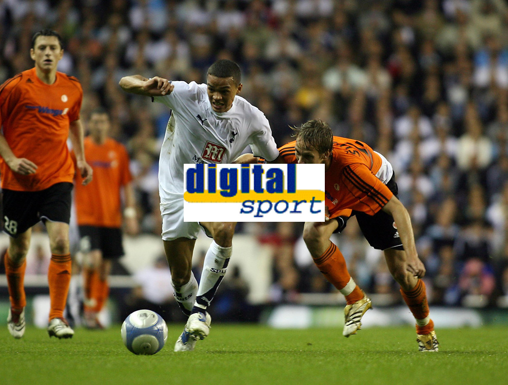 Photo: Chris Ratcliffe.<br /> Tottenham Hotspur v Slavia Prague. UEFA Cup. 28/09/2006.<br /> Jermaine Jenas of Spurs clashes with Michal Svec of Slavia Prague.