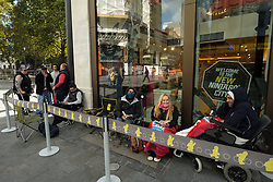 © Licensed to London News Pictures. 13/09/2017. London, UK. Customers queue up outside the Lego flagship store to buy a limited edition Star Wars Millennium Falcon. Made from 7,500 pieces, the Lego set is the largest ever will retail for £650. Photo credit: Ray Tang/LNP