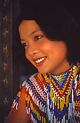 Young Thai woman in traditional bead dress, Bangkok