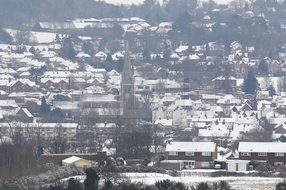 © Licensed to London News Pictures. 18/03/2018. Dorking, UK. Snow covers the rooftops in Dorking, Surrey after overnight snow and freezing temperatures. Amber weather warnings remain in place for parts of the UK for a second day. Photo credit: Peter Macdiarmid/LNP