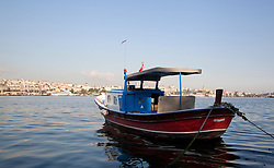 Small fishing boat in the Bosphorus, Istanbul, Istanbul, Turkey, September 2012. Photo by Silvia Baron / i-Images.