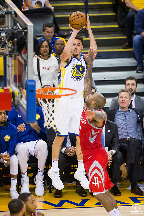 Golden State Warriors guard Klay Thompson (11) shoots a three pointer against the Houston Rockets during Game 6 of the Western Conference Finals at Oracle Arena in Oakland, Calif., on May 26, 2018. (Stan Olszewski/Special to S.F. Examiner)