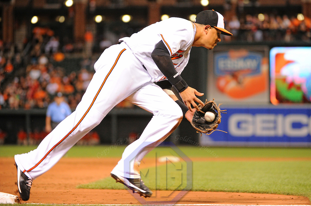 25 July 2016:  Baltimore Orioles third baseman Manny Machado (13) makes a running catch against the Colorado Rockies at Orioles Park at Camden Yards in Baltimore, MD. in interleague play. The Baltimore Orioles defeated the Colorado Rockies, 3-2 in ten innings. (Photograph by Mark Goldman/Icon Sportswire)