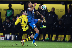 DORTMUND, Dec. 17, 2017  Kerem Demirbay of Hoffenheim and Raphael Guerreiro (L) of Dortmund battle for the ball during the Bundesliga match between Borussia Dortmund and TSG 1899 Hoffenheim at Signal Iduna Park on December 16, 2017 in Dortmund, Germany. Dortmund won 2-1. (Credit Image: © Joachim Bywaletz/Xinhua via ZUMA Wire)