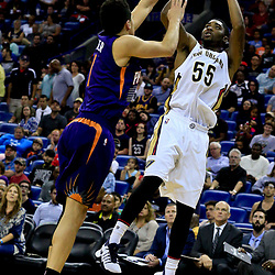 Nov 4, 2016; New Orleans, LA, USA; New Orleans Pelicans guard E'Twaun Moore (55) shoots over Phoenix Suns guard Devin Booker (1) during the second quarter of a game at the Smoothie King Center. Mandatory Credit: Derick E. Hingle-USA TODAY Sports