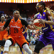 UNCASVILLE, CONNECTICUT- MAY 26: Essence Carson #17 of the Los Angeles Sparks drives past Alex Bentley #20 of the Connecticut Sun in action during the Los Angeles Sparks Vs Connecticut Sun, WNBA regular season game at Mohegan Sun Arena on May 26, 2016 in Uncasville, Connecticut. (Photo by Tim Clayton/Corbis via Getty Images)