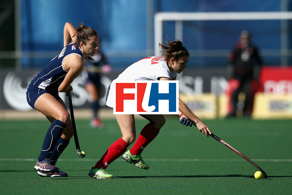 JOHANNESBURG, SOUTH AFRICA - JULY 20: Amelia Katerla of Poland and Sofia Walbaum of Chile battle for possession during the 9th/10th Place playoff match between Poland and Chile during Day 7 of the FIH Hockey World League - Women's Semi Finals on July 20, 2017 in Johannesburg, South Africa.  (Photo by Jan Kruger/Getty Images for FIH)