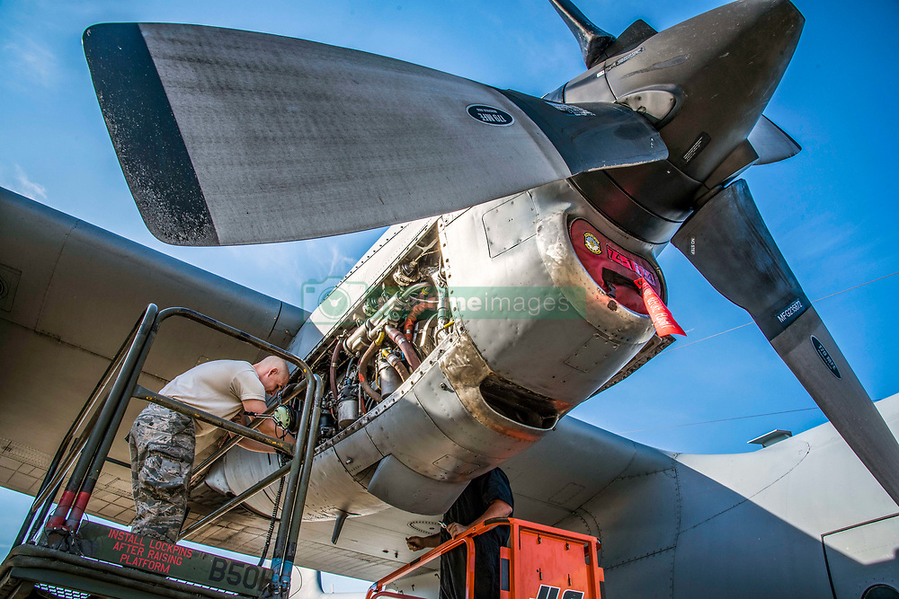 "Senior Airman Tim Johnson and Senior Airman Hunter Mitchell, both 179th Airlift Wing Maintenance Group aerospace propulsion specialists, , evaluate an engine of the C-130H Hercules while it is running June 26, 2018, in Mansfield, Ohio. The diagnostic test requires the engine to be running for the Airman to properly identify the cause of this particular issue and is also known by aircraft mechanics as ""man on the stand."" (U.S. Air National Guard photo by Capt. Paul Stennett)"
