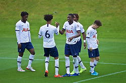 KIRKBY, ENGLAND - Saturday, August 10, 2019: Tottenham Hotspur's Shilow Tracey (R) celebrates scoring the fourth goal with team-mates during the Under-23 FA Premier League 2 Division 1 match between Liverpool FC and Tottenham Hotspur FC at the Academy. (Pic by David Rawcliffe/Propaganda)