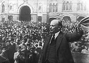Russian Revolution, October 1917. Vladimir Ilyich Lenin (Ulyanov) 1870-1924 addressing the crowd in Red Square, Moscow.  Photograph.