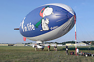 Montgomery, NY - Members of the ground crew work on the MetLife blimp Snoopy Two after securing the blimp to the mooring mast at Orange County Airport on July 25, 2008.