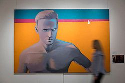 "© Licensed to London News Pictures. 03/06/2016. London, UK. A staff member walks in front of Georgy Gurianov's ""Self-Portrait"" (est. GBP 80,000-120,000), at a preview of Sotheby's Russian and contemporary central and eastern European art sale which takes place in London on 7 June. Photo credit : Stephen Chung/LNP"