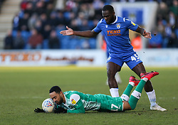 Byron Moore of Plymouth Argyle goes under a challenge from Frank Nouble of Colchester United - Mandatory by-line: Arron Gent/JMP - 08/02/2020 - FOOTBALL - JobServe Community Stadium - Colchester, England - Colchester United v Plymouth Argyle - Sky Bet League Two