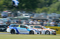 #31 Jack Goff GBR Team IHG Rewards Club BMW 125i M Sport passing #20 James Cole GBR Subaru Team BMR Subaru Levorg GT  during the BTCC Oulton Park 4th-5th June 2016 at Oulton Park, Little Budworth, Cheshire, United Kingdom. June 05 2016. World Copyright Peter Taylor/PSP.