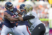 06 October 2013: Defensive end (94) Cameron Jordan of the New Orleans Saints rushes against (67) Jordan Mills of the Chicago Bears during the first half of the Saints 26-18 victory over the Bears in an NFL Game at Soldier Field in Chicago, IL.