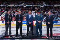 REGINA, SK - MAY 19: Derek Niedermayer of the Royal Canadian Legion, Paul Brown of the Real Canadian Superstore, Mike Sillinger of the Regina Pats Alumni, Lieutenant Colonel Jody McKinnon of the Canadian Armed Forces and Ron Robison of the WHL stand at centre ice for the ceremonial puck drop between the Acadie-Bathurst Titan and the Swift Current Broncos at the Brandt Centre on May 19, 2018 in Regina, Canada. (Photo by Marissa Baecker/CHL Images)