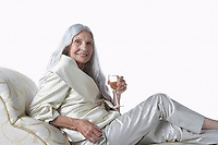 Senior Woman Having Glass of Champagne