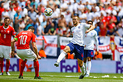 England midfielder Eric Dier (Tottenham) puts the ball over Switzerland midfielder Granit Xhaka (10) during the UEFA Nations League 3rd place play-off match between Switzerland and England at Estadio D. Afonso Henriques, Guimaraes, Portugal on 9 June 2019.