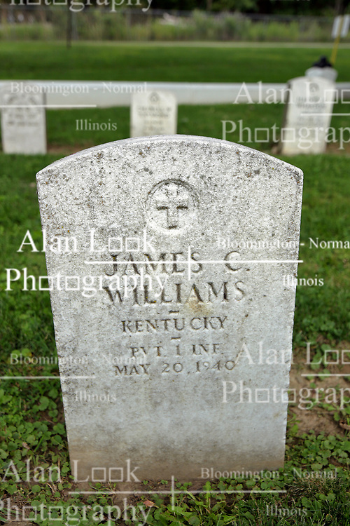 26 August 2017:   A part of the History of McLean County Illinois.<br /> <br /> Tombstones in Evergreen Memorial Cemetery.  Civic leaders, soldiers, and other prominent people are featured. Section 5, the old town soldiers area<br /> James C Williams  Kentucky  Private 1 INF  May 20, 1940