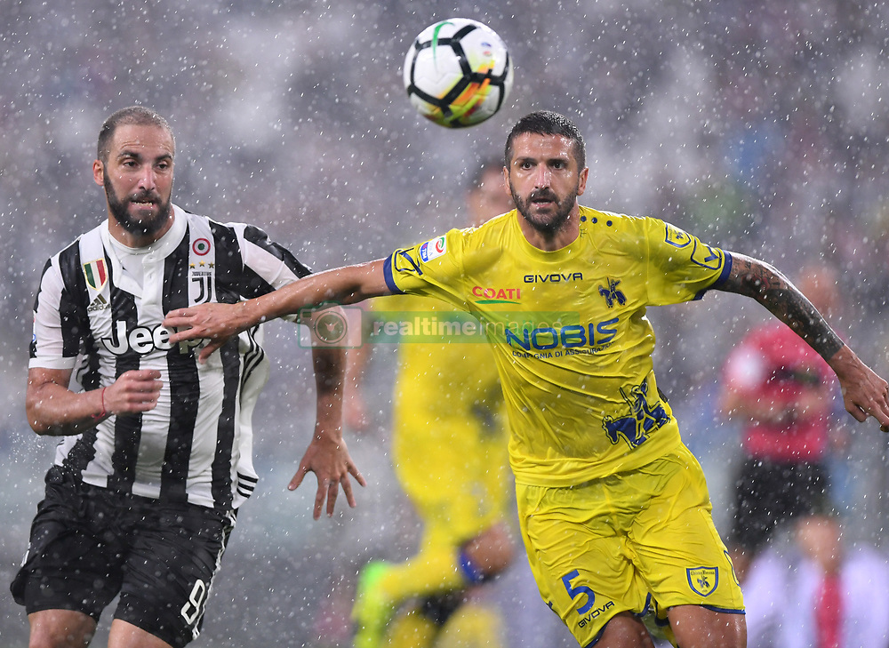 TURIN, Sept. 10, 2017  Juventus' Gonzalo Higuain (L) vies with Chievo's Alessandro Gamberini during the Italian Serie A soccer match between Juventus and Chievo, in Turin, Italy, Sept. 9, 2017. Juventus won 3-0. (Credit Image: © Alberto Lingria/Xinhua via ZUMA Wire)