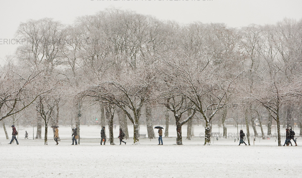 People make there way to work through the snowfall in Edinburgh's Meadows..Heavy snow has fallen across large parts of the UK, disrupting travel and closing thousands of schools.  Weather warnings of heavy and drifting snow are also in place for many southern and eastern parts of Scotland.