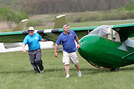 Wurtsboro, NY - Two men move a restored Schweizer 2-33 glider at the grand reopening of Wurtsboro Airport on May 11, 2008.