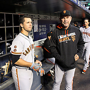 NEW YORK, NEW YORK - APRIL 29:  Manager Bruce Bochy #15, (right), and catcher Buster Posey #28 of the San Francisco Giants preparing to bat San Francisco Giants MLB regular season game at Citi Field on April 29, 2016 in New York City. (Photo by Tim Clayton/Corbis via Getty Images)