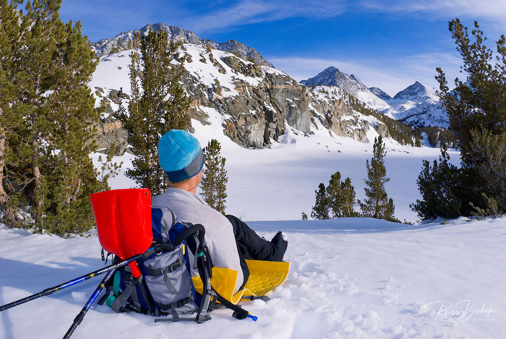 Backcountry skier enjoying a rest in Little Lakes Valley, Inyo National Forest, Sierra Nevada Mountains, California