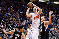 PHOENIX, AZ - APRIL 13:  Alex Len #21 of the Phoenix Suns drives the ball against Pablo Prigioni #9 of the Los Angeles Clippers in the second half at Talking Stick Resort Arena on April 13, 2016 in Phoenix, Arizona.  The Los Angeles Clippers won 114 - 105.  NOTE TO USER: User expressly acknowledges and agrees that, by downloading and or using this photograph, User is consenting to the terms and conditions of the Getty Images License Agreement. (Photo by Jennifer Stewart/Getty Images)