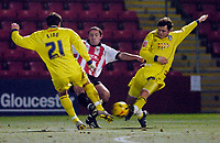 Photo: Leigh Quinnell.<br /> Cheltenham Town v Colchester United. LDV Vans Trophy.<br /> 24/01/2006. Cheltenhams JJ Melligan can't find a way past Colchesters Robbie King(L)