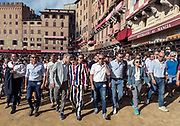 Italy, Siena, the Palio:: Giovanni Atzeni, called Tittia from the Istrice contrada.  the contradas parade after the trial Povraccia After this test, captains and jockeys gather at the City Hall to enscribe the jockey and show his colors. After this the jockey can no longer be changed.